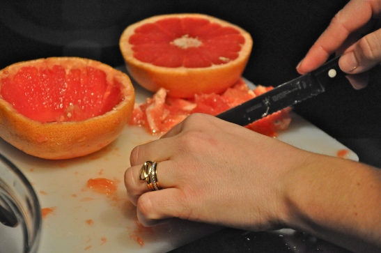 Section the citrus and throw it in a bowl. You can use whatever you have and like. In this case, I used red grapefruit. (Rachel Nania)